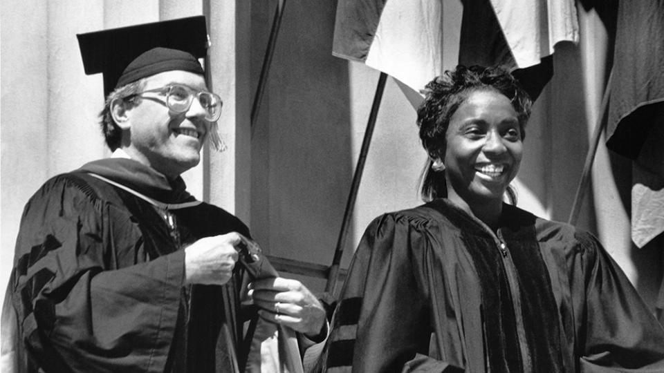 Valerie Taylor being hooded by David Messerschmitt in 1991